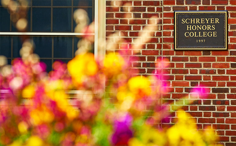 Schreyer Honors College sign with flowers
