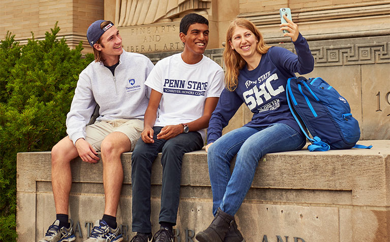 Three Scholars taking a selfie at Paterno and Pattee Libraries