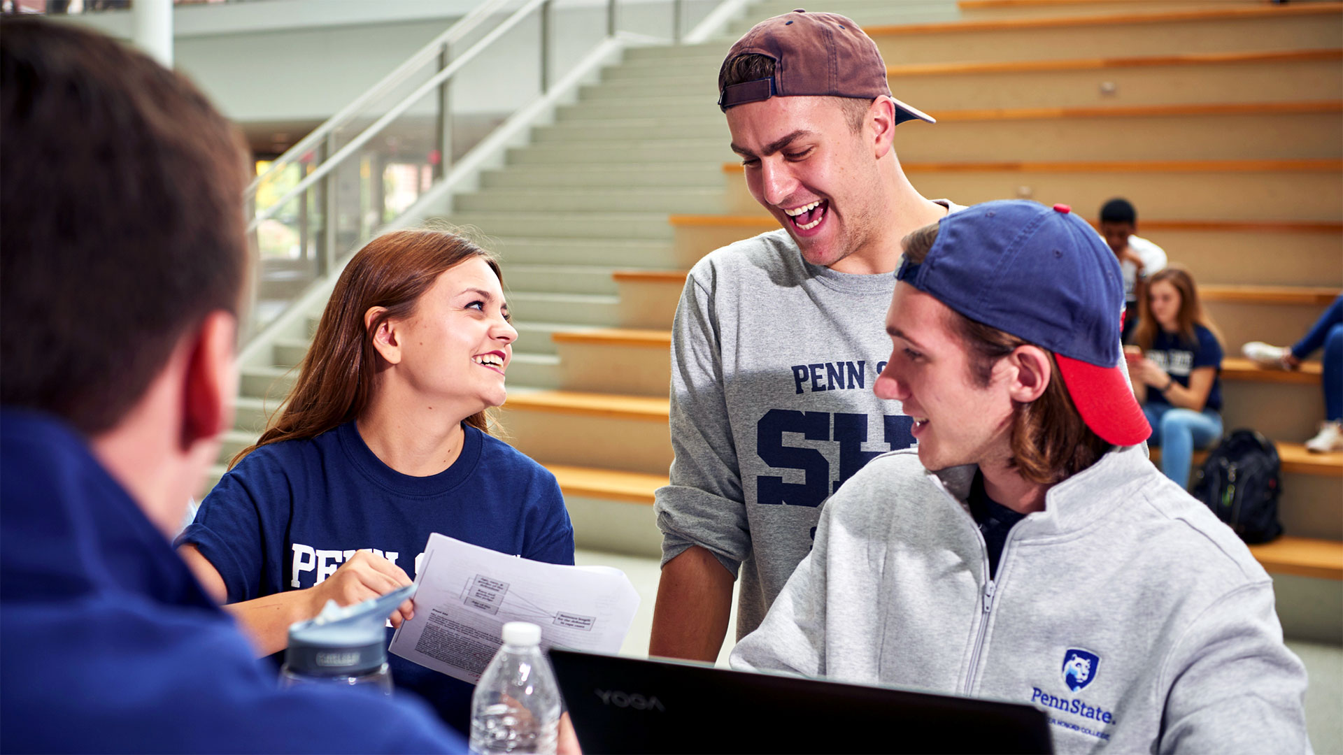 Schreyer Scholars laughing and working in the HUB