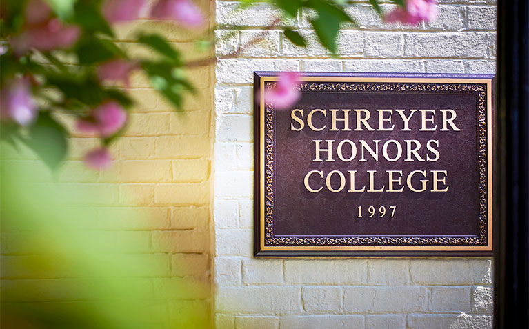 Schreyer Honors College sign in the Atherton Hall courtyard