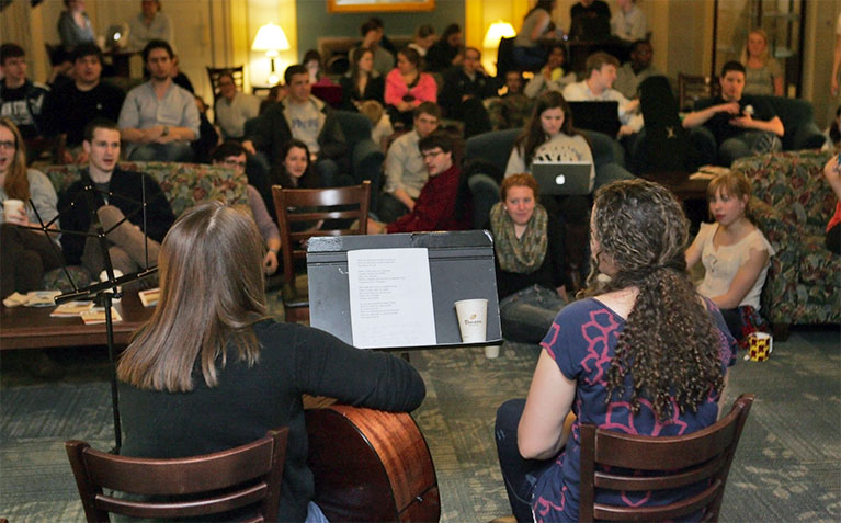 Scholars playing and signing at SHC Coffeehouse session